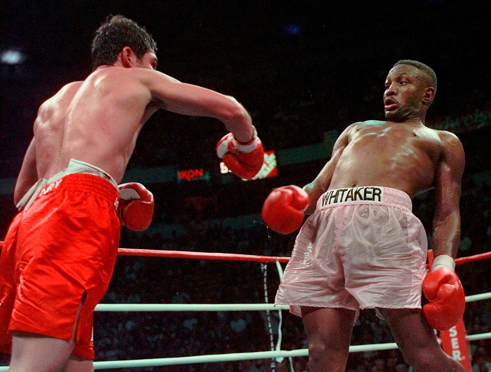 FILE - In this April 12, 1997, file photo, Pernell Whitaker, right, leans away from a punch by Oscar De La Hoya during their WBC Welterweight Championship fight at Thomas & Mack Center in Las Vegas.{ } (AP Photo/Eric Draper, File)