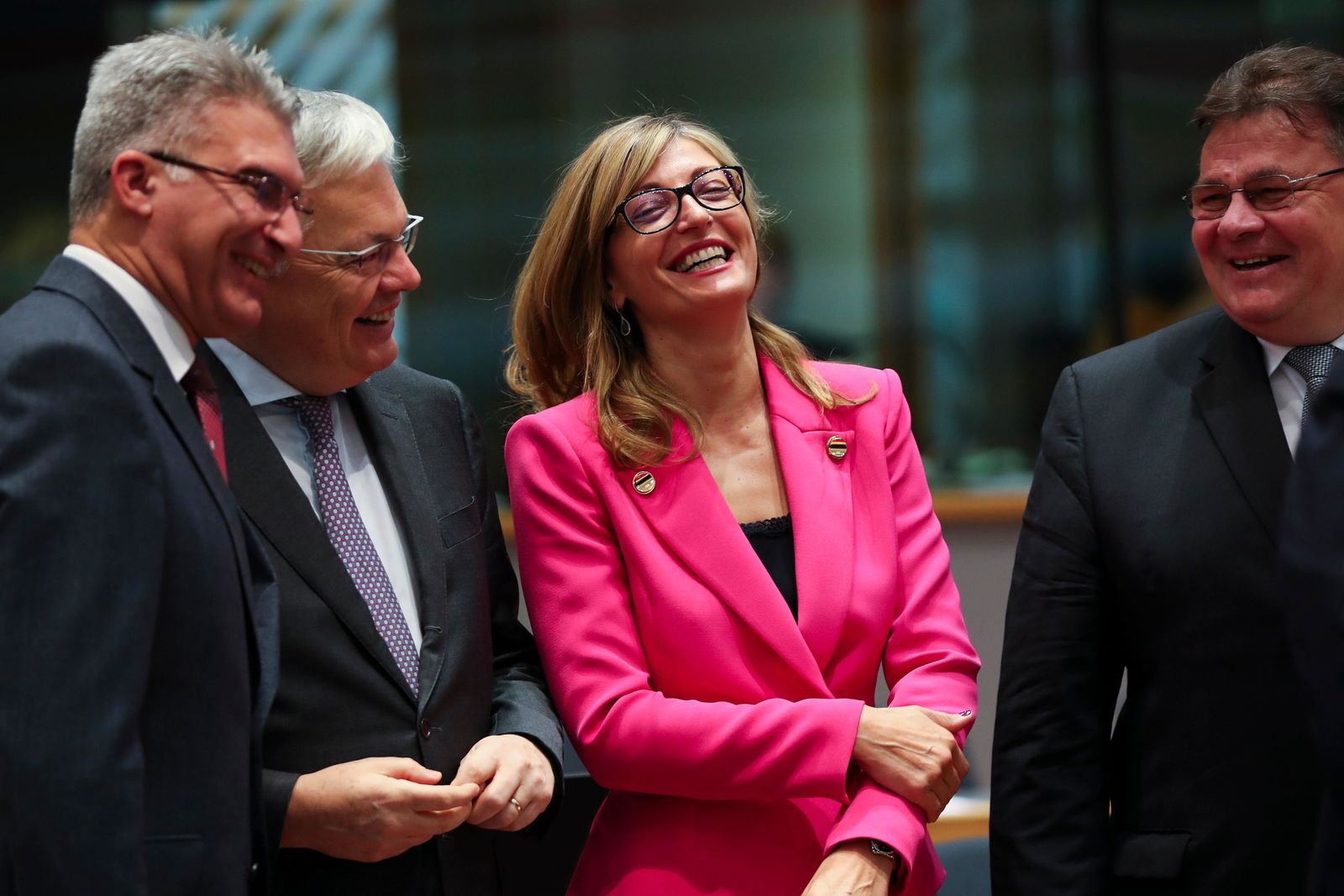 Bulgarian Foreign Minister Ekaterina Zaharieva, second right, talks to Malta's Foreign Minister Carmelo Abela, left, Lithuanian Foreign Minister Linas Linkevicius, right, and Belgium Foreign Minister Didier Reynders during an European Foreign Affairs Ministers meeting at the Europa building in Brussels, Monday, Nov. 11, 2019. (AP Photo/Francisco Seco)