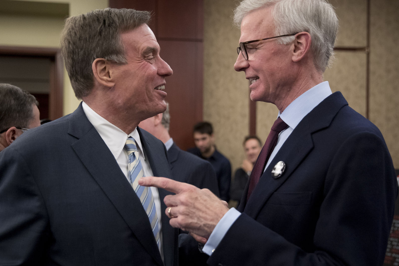 Sen. Mark Warner, D-Va., left, speaks with Washington Post Publisher Fred Ryan, right, at an event marking 100 days since the death of Jamal Khashoggi on Capitol Hill in Washington, Thursday, Jan. 10, 2019. Amnesty International on Thursday renewed a call for an international investigation into the killing of Washington Post columnist Jamal Khashoggi. (AP Photo/Andrew Harnik)