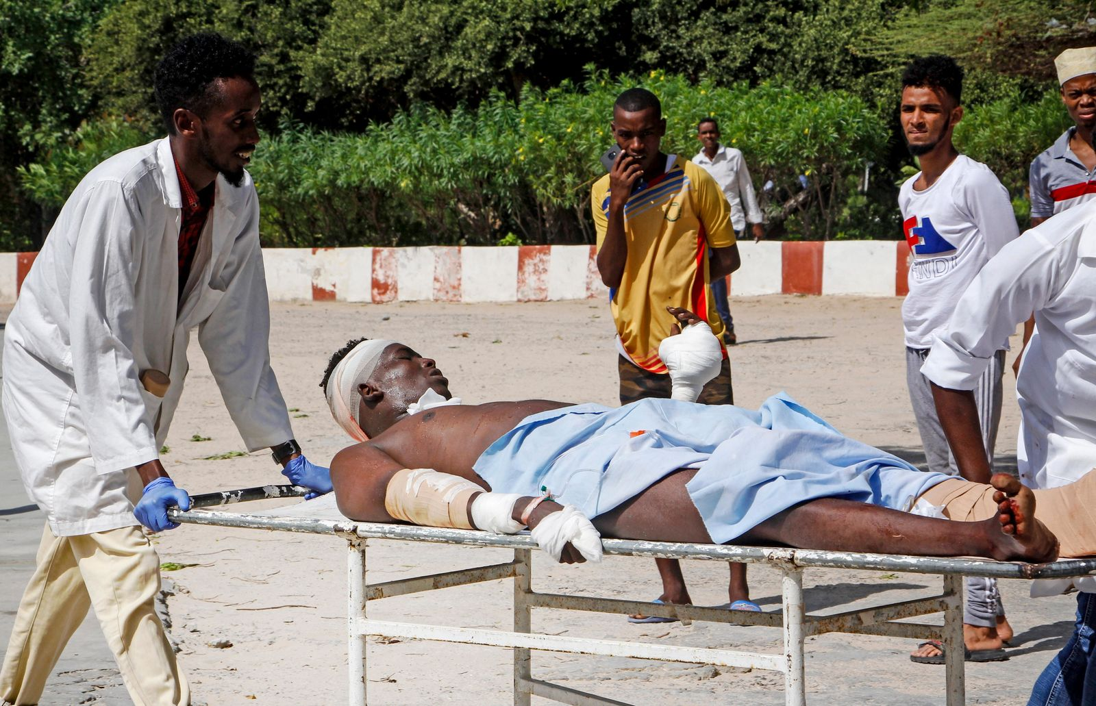 Medical workers help a man who was wounded in a bomb attack, at a hospital in the capital Mogadishu, Somalia Saturday, June 15, 2019. (AP Photo/Farah Abdi Warsameh)