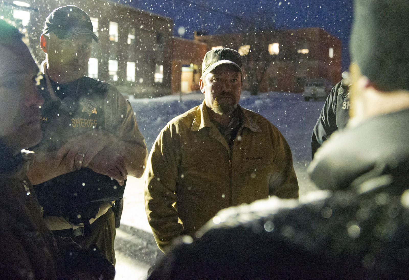 "Members of ""the Idaho 3%"" and the group's president, Brandon Curtiss, meet with Sheriff Dave Ward outside of the Harney County Courthouse on Saturday, Jan 9, 2016 in Burns, Ore.  A small, armed group has been occupying a remote national wildlife refuge in Oregon for a week to protest federal land use policies.  (Dave Killen/The Oregonian via AP) MAGS OUT; TV OUT; NO LOCAL INTERNET; THE MERCURY OUT; WILLAMETTE WEEK OUT; PAMPLIN MEDIA GROUP OUT; MANDATORY CREDIT"