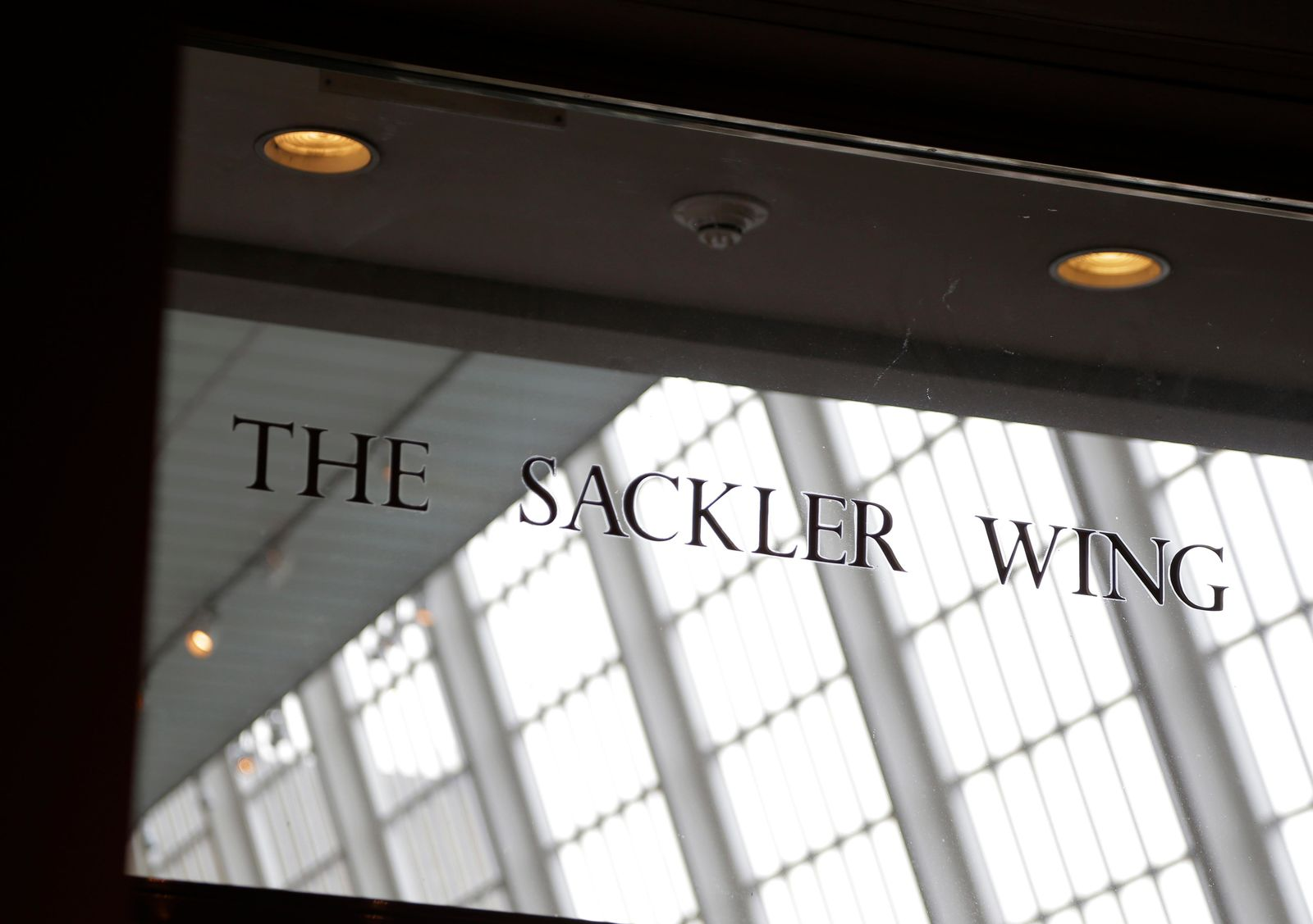 A sign with the Sackler name is displayed at the Metropolitan Museum of Art in New York, Thursday, Jan. 17, 2019.{ } (AP Photo/Seth Wenig)