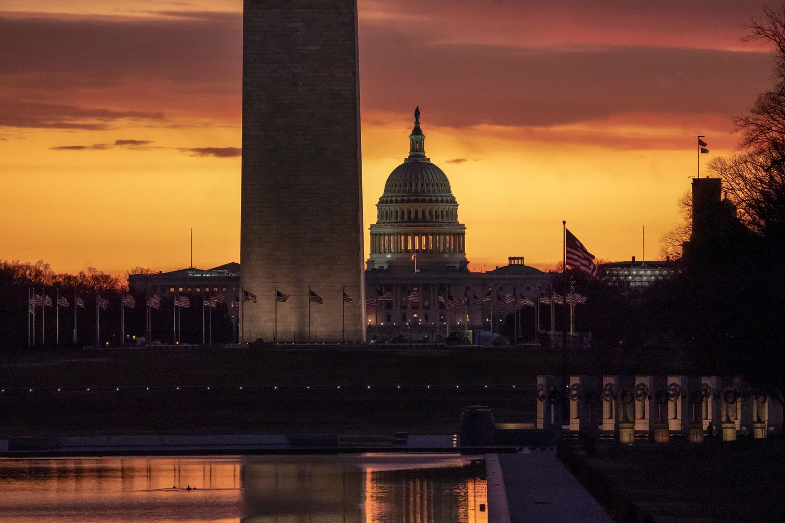 The Capitol and Washington Monument are seen at dawn as the partial government shutdown lurches into a third week with President Donald Trump standing firm in his border wall funding demands, in Washington, Monday, Jan. 7, 2019. (AP Photo/J. Scott Applewhite)