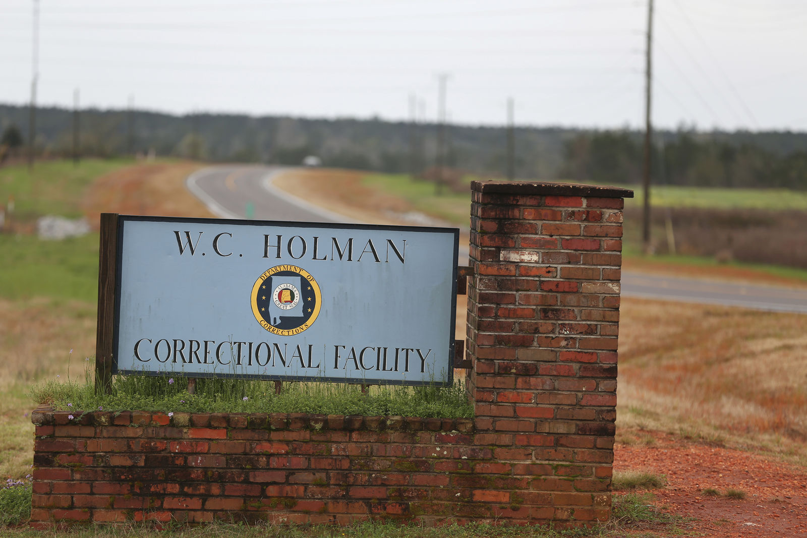 FILE -In this March 12, 2016 file photo, the sign to The William C. Holman Correctional Facility in Atmore, Ala., is displayed. (Sharon Steinmann/AL.com via AP, File)