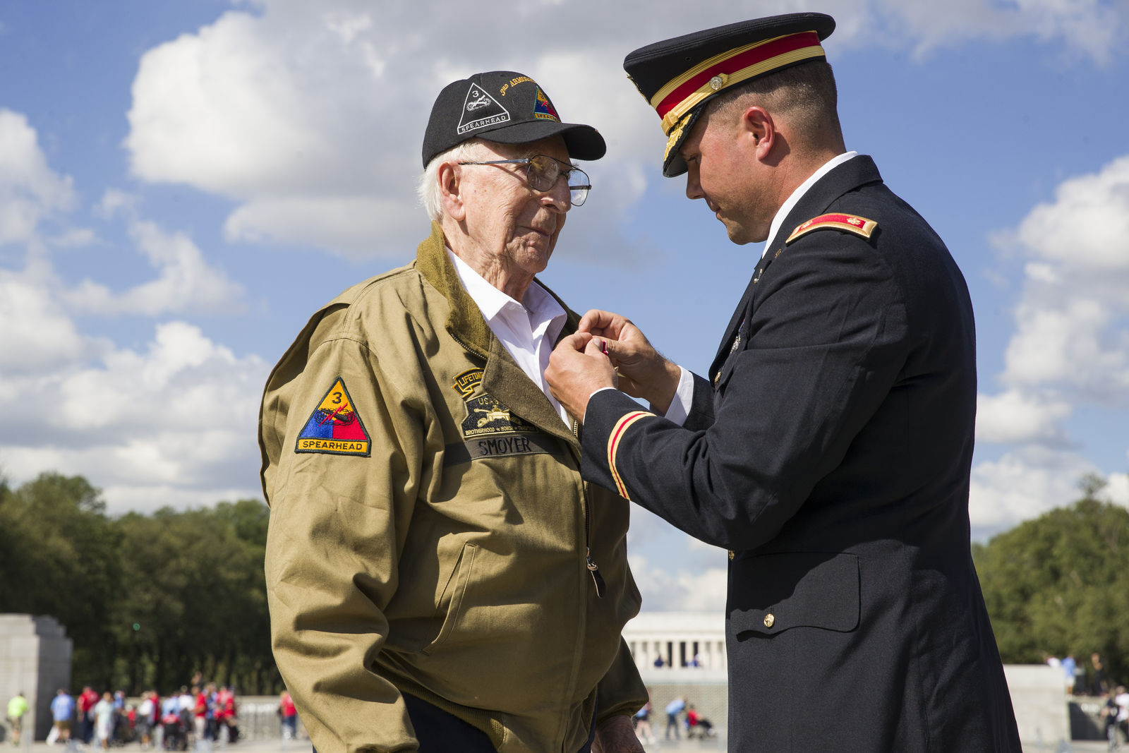 World War II veteran Clarence Smoyer, 96, receives the Bronze Star from U.S. Army Maj. Peter Semanoff at the World War II Memorial, Wednesday, Sept. 18, 2019, in Washington. (AP Photo/Alex Brandon)