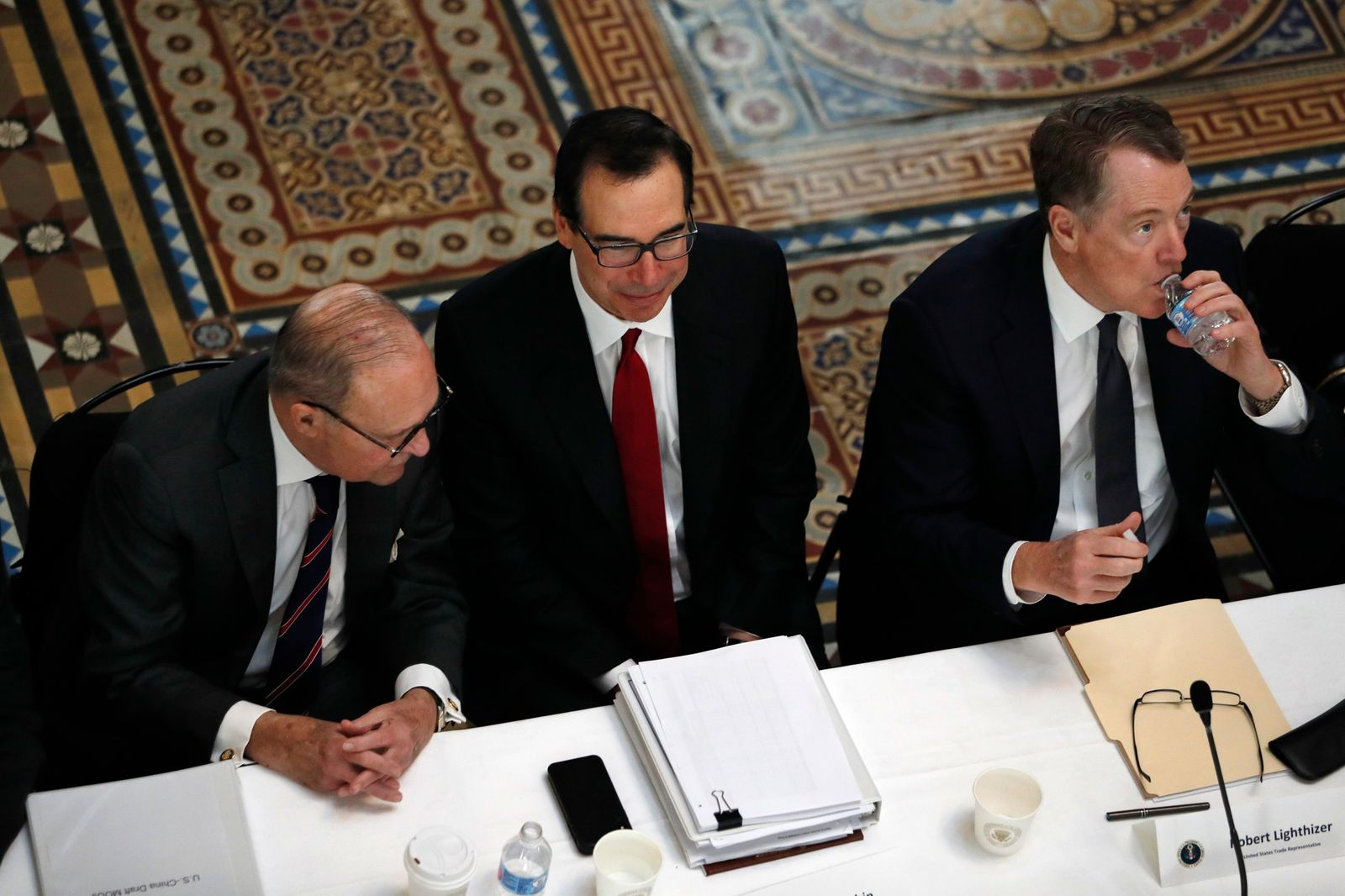 FILE- In this Feb. 21, 2019, file photo White House economic adviser Larry Kudlow, left, Treasury Secretary Steve Mnuchin, and U.S. Trade Representative Robert Lighthizer, attend a meeting of senior U.S. and Chinese officials to resume trade negotiations in Washington.{ } (AP Photo/Jacquelyn Martin, File)