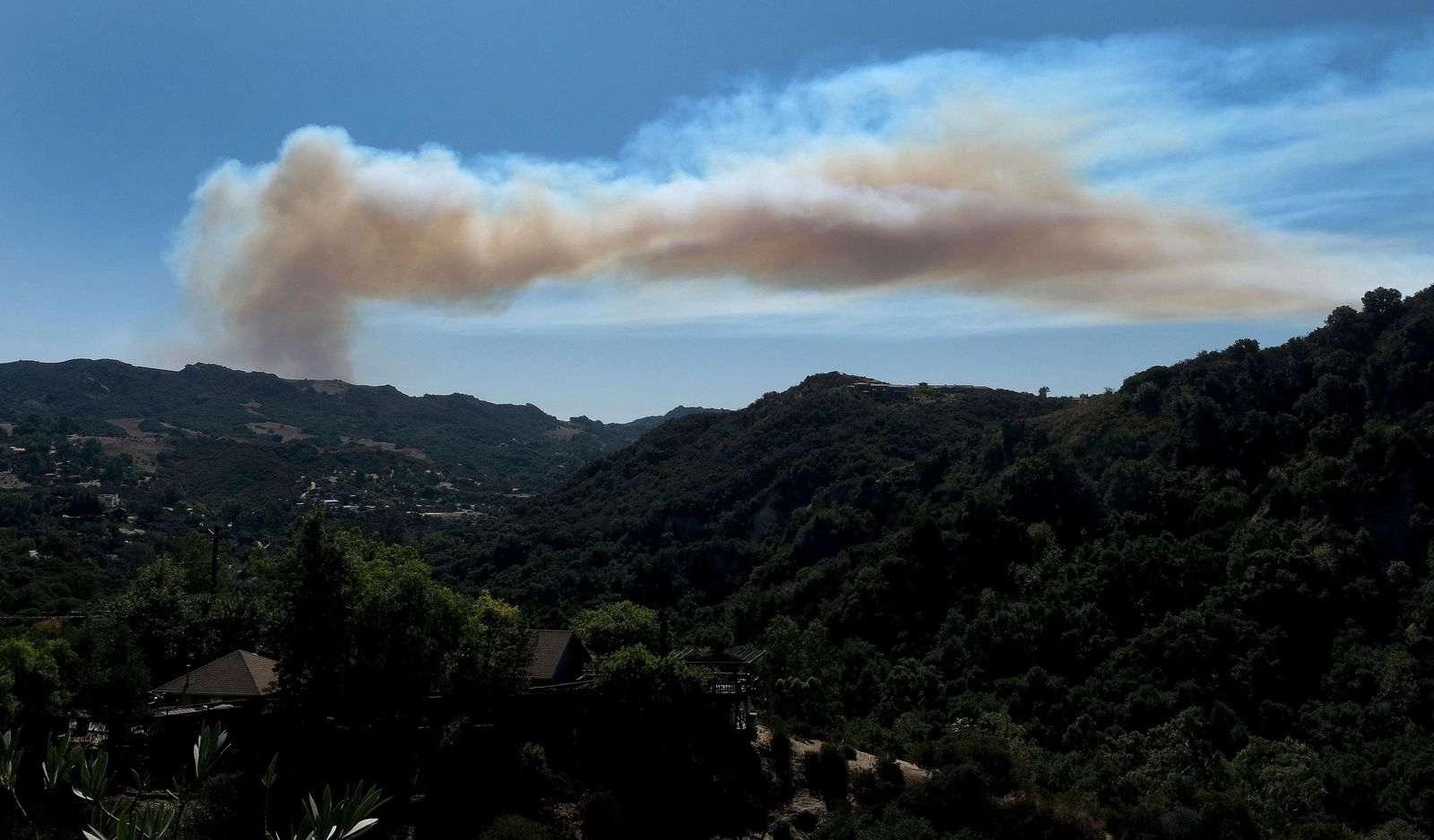 A giant plume of smoke rises from a fire in Pacific Palisades, as seen from Topanga Canyon in Topanga, Calif., Monday, Oct. 21, 2019. (Dean Musgrove/The Orange County Register via AP)