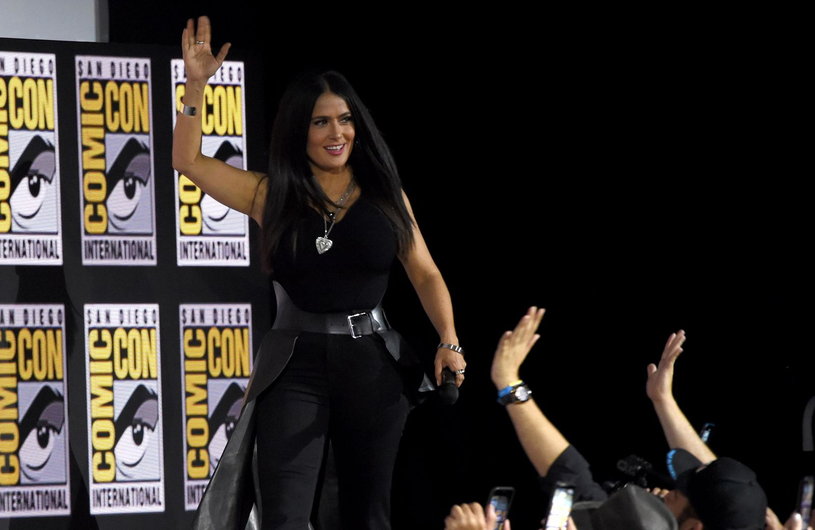 Salma Hayek waves to the fans as she walks on stage at the Marvel Studios panel on day three of Comic-Con International on Saturday, July 20, 2019, in San Diego. (Photo by Chris Pizzello/Invision/AP)
