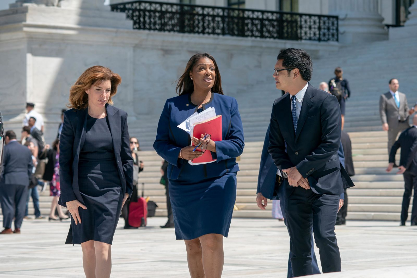 From left, New York City Census Director Julie Menin, New York State Attorney General Letitia James, and Dale Ho, an attorney for the American Civil Liberties Union, leaves after the Supreme Court heard arguments over the Trump administration's plan to ask about citizenship on the 2020 census, in Washington, Tuesday, April 23, 2019.{ } (AP Photo/J. Scott Applewhite)