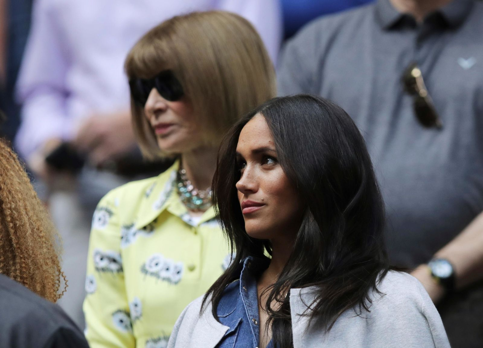 Meghan, Duchess of Sussex, right, and Anna Wintour wait for the start of the women's singles final of the U.S. Open tennis championships between Serena Williams, of the United States, and Bianca Andreescu, of Canada, Saturday, Sept. 7, 2019, in New York. (AP Photo/Charles Krupa)