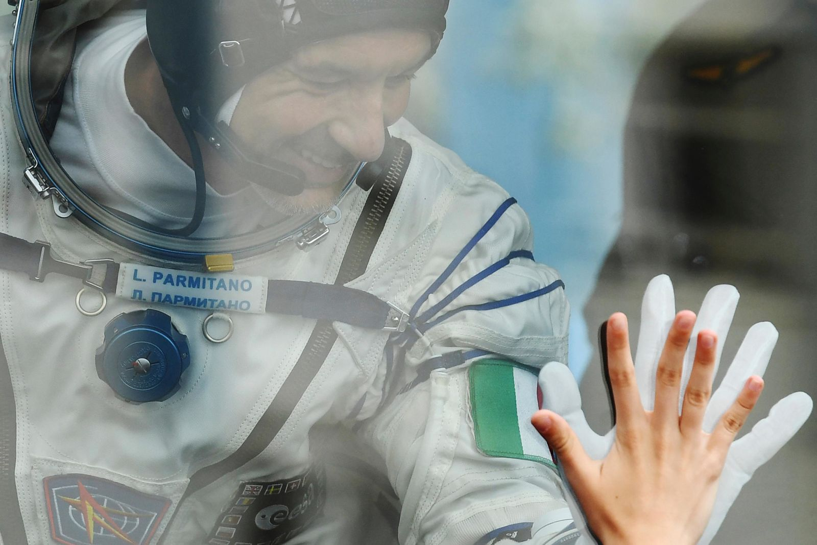 Italian astronaut Luca Parmitano, member of the main crew of the expedition to the International Space Station (ISS), gestures to his relatives from a bus prior the launch of Soyuz MS-13 space ship at the Russian leased Baikonur cosmodrome, Kazakhstan, Saturday, July 20, 2019. (AP Photo/, Pool)