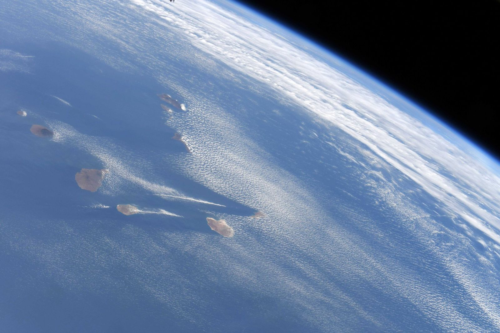 Easy to tell which way the wind is blowing over the Canaries.  (Photo & Caption David Saint-Jacques, NASA)
