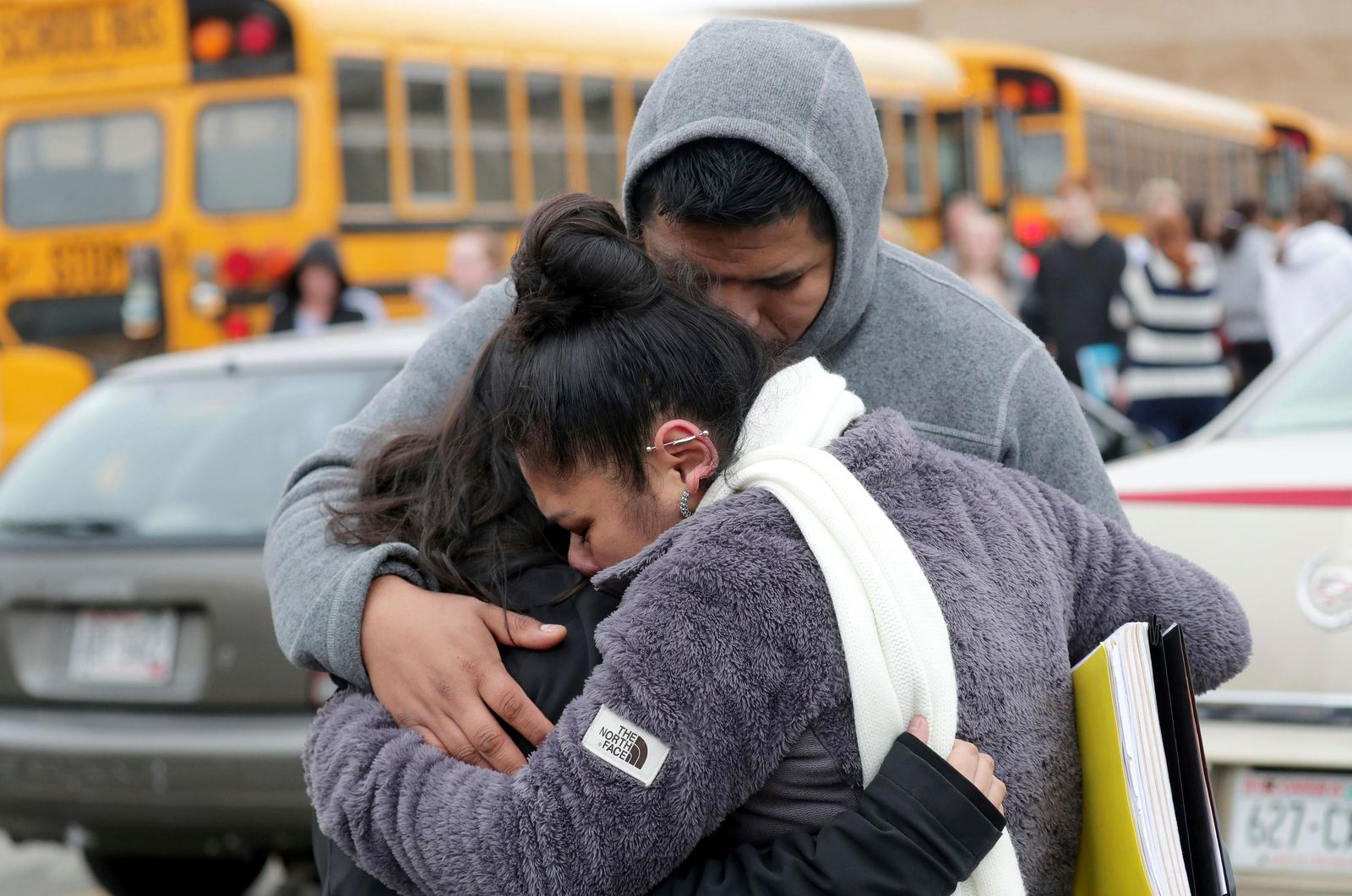 Becky Galvan, center, consoles her daughter, Ashley Galvan, a 15-year-old sophomore, with her father Jose Chavez outside Waukesha South High School in Waukesha on Monday, Dec. 2, 2019. (Mike De Sisti/Milwaukee Journal-Sentinel via AP)