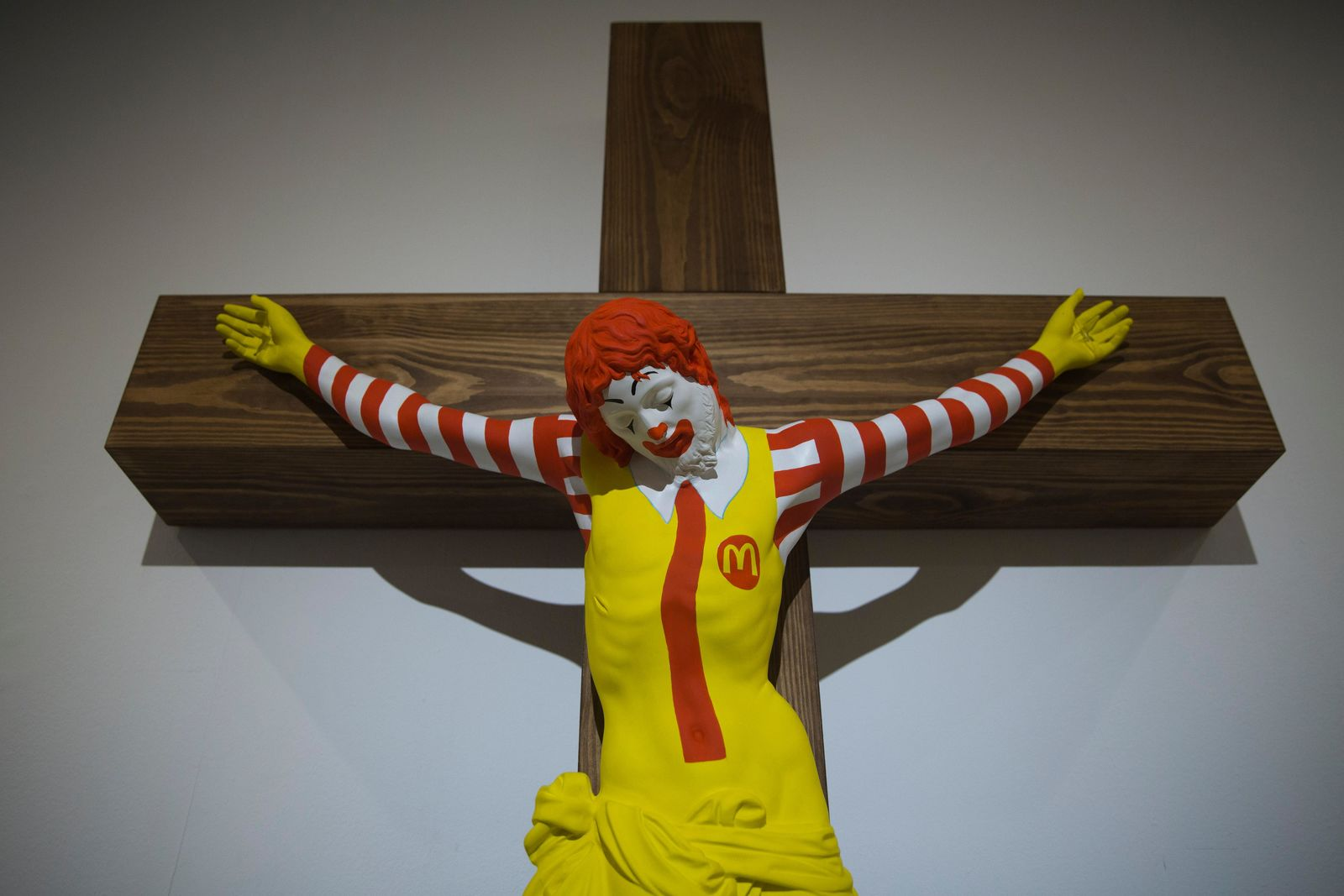 "An artwork called ""McJesus,"" which was sculpted by Finnish artist Jani Leinonen and depicts a crucified Ronald McDonald, is seen on display as part of the Haifa museum's ""Sacred Goods"" exhibit, in Haifa, Israel, Monday, Jan. 14, 2019.{ } (AP Photo/Oded Balilty)"