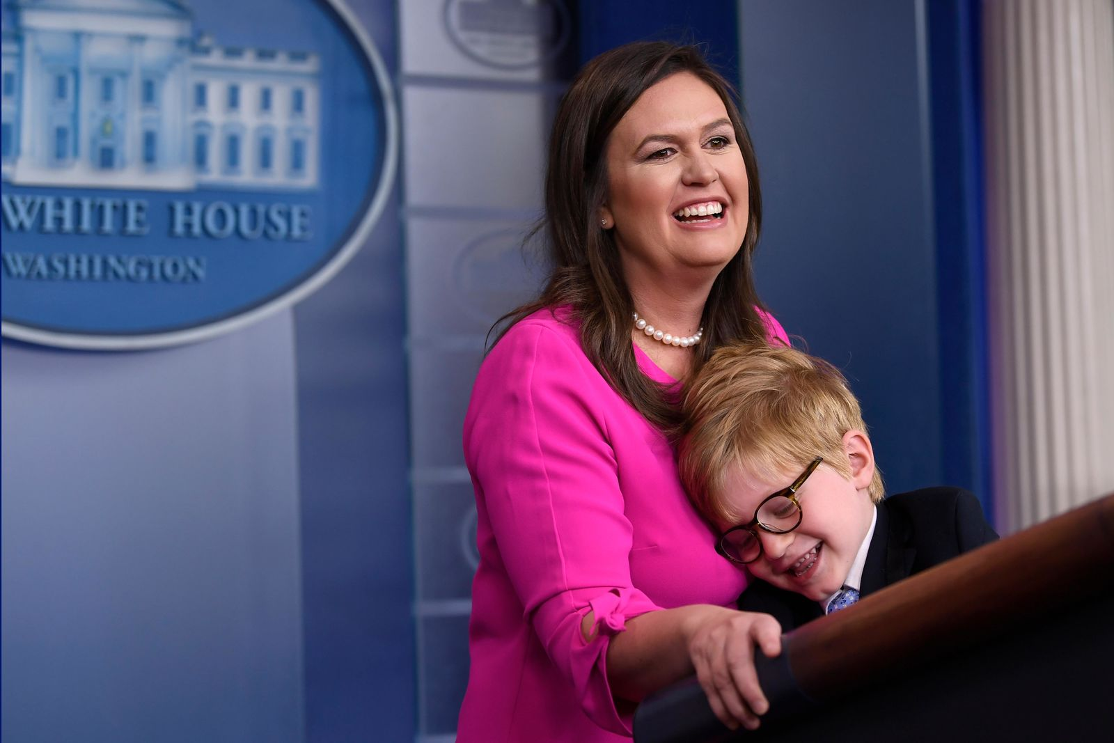 White House press secretary Sarah Sanders, standing next to her son Huck Sanders, speaks during a briefing at the White House in Washington, Thursday, April 25, 2019. (AP Photo/Susan Walsh)
