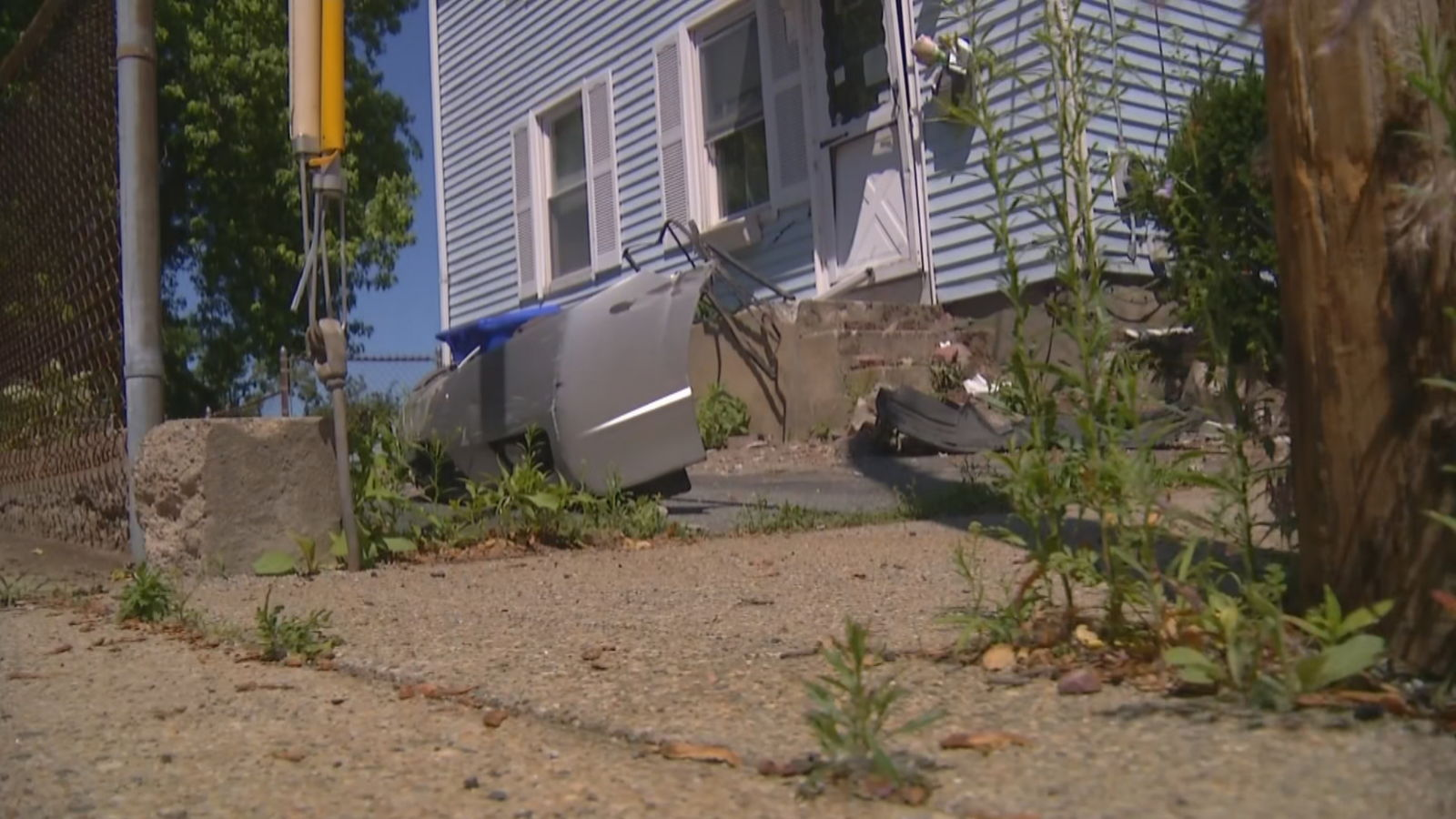 Pawtucket police responded to Hurley Avenue Saturday, June 15, 2019 after a woman lost control of her car and crashed into the concrete stairs of a home, causing the car to rollover. (WJAR)<p></p>