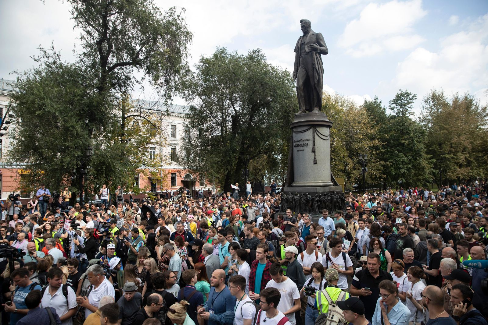 People attend a protest march in Moscow, Russia, the statue of famous Russian poet Alexander Griboyedov in the background, Saturday, Aug. 31, 2019. (AP Photo/Pavel Golovkin)
