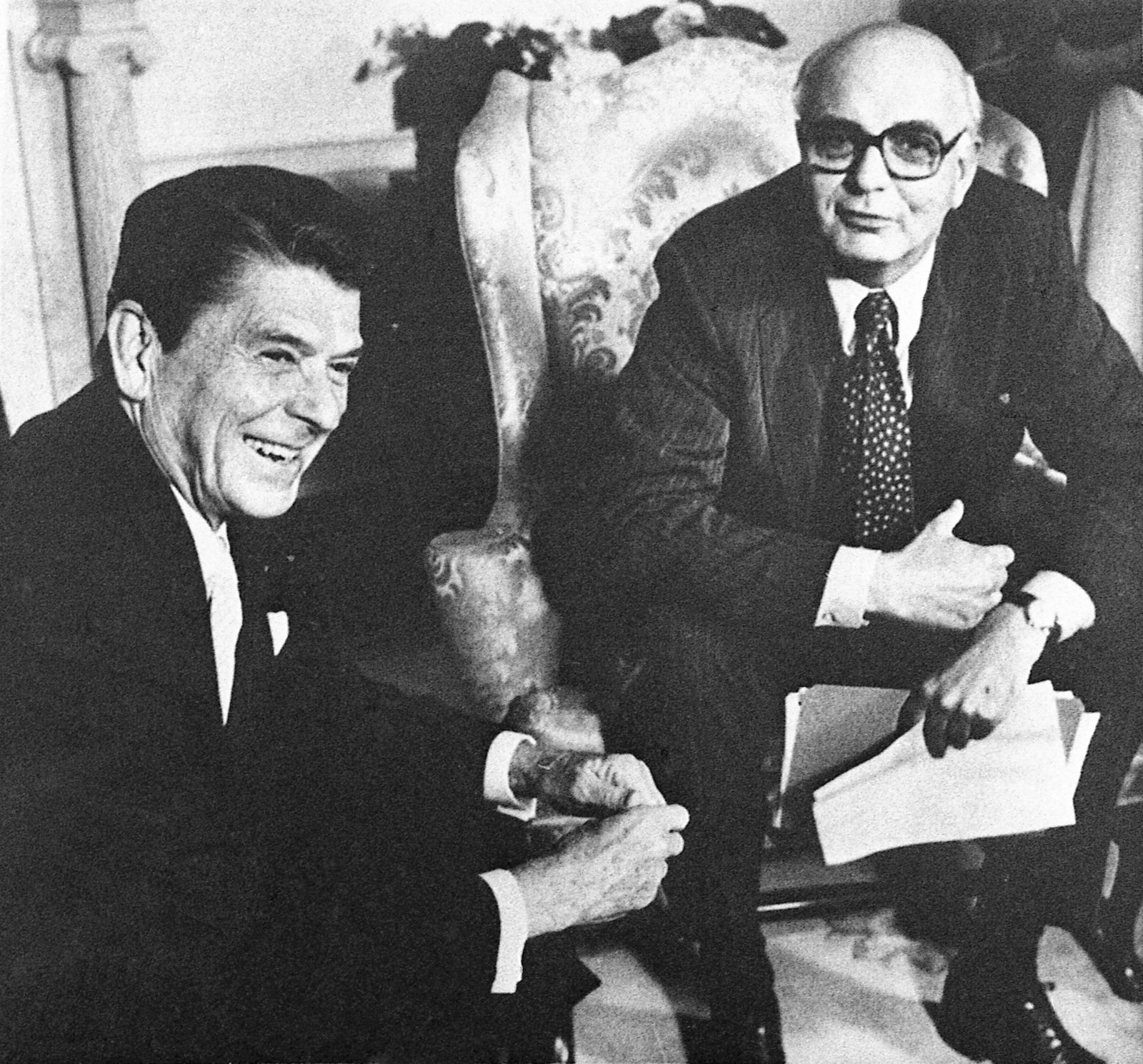FILE - In this July 16, 1981, file photo Federal Reserve Board chairman Mr. Paul Volcker, right, meets with President Ronald Reagan in the Oval Office in Washington. Volcker, the former Federal Reserve chairman died on Sunday, Dec. 8, 2019, according to his office, He was 92.{ }(AP Photo/J. Scott Applewhite File)