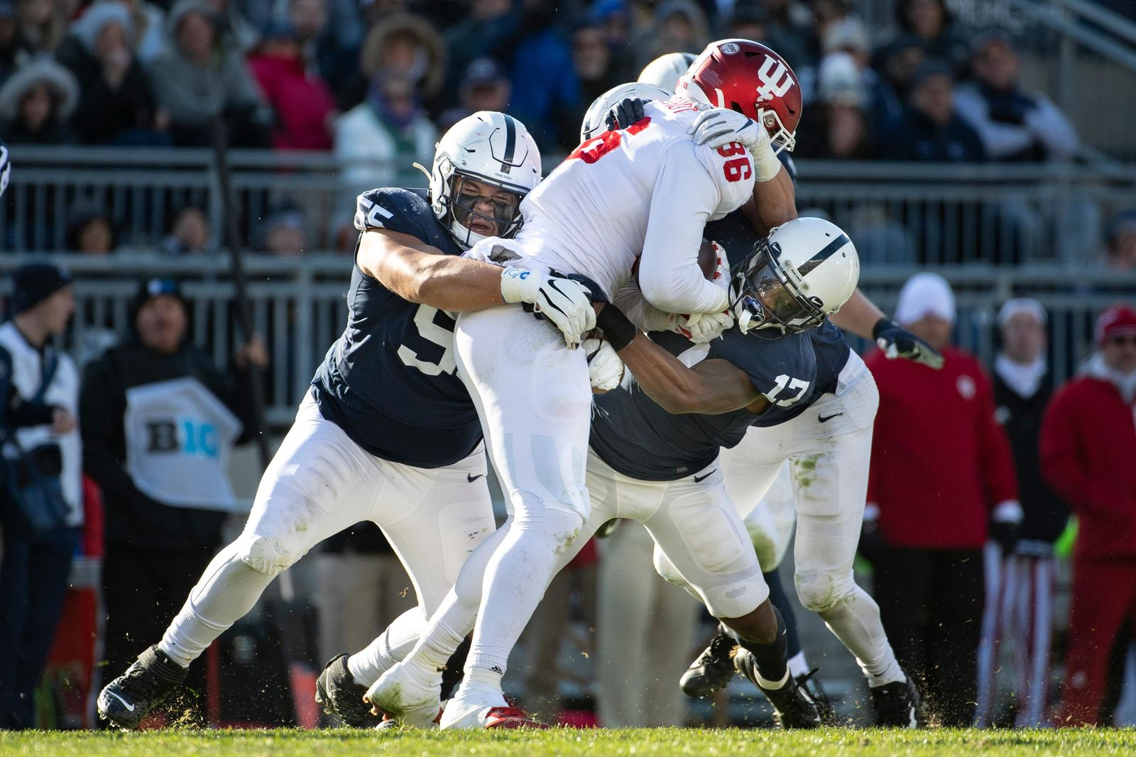 Penn State defenders Antonio Shelton (55) and Garrett Taylor (17) stop Indiana tight end Peyton Hendershot (86) on a fake punt in the third quarter of an NCAA college football game in State College, Pa., on Saturday, Nov.16, 2019. Penn State defeated 34-27. (AP Photo/Barry Reeger)