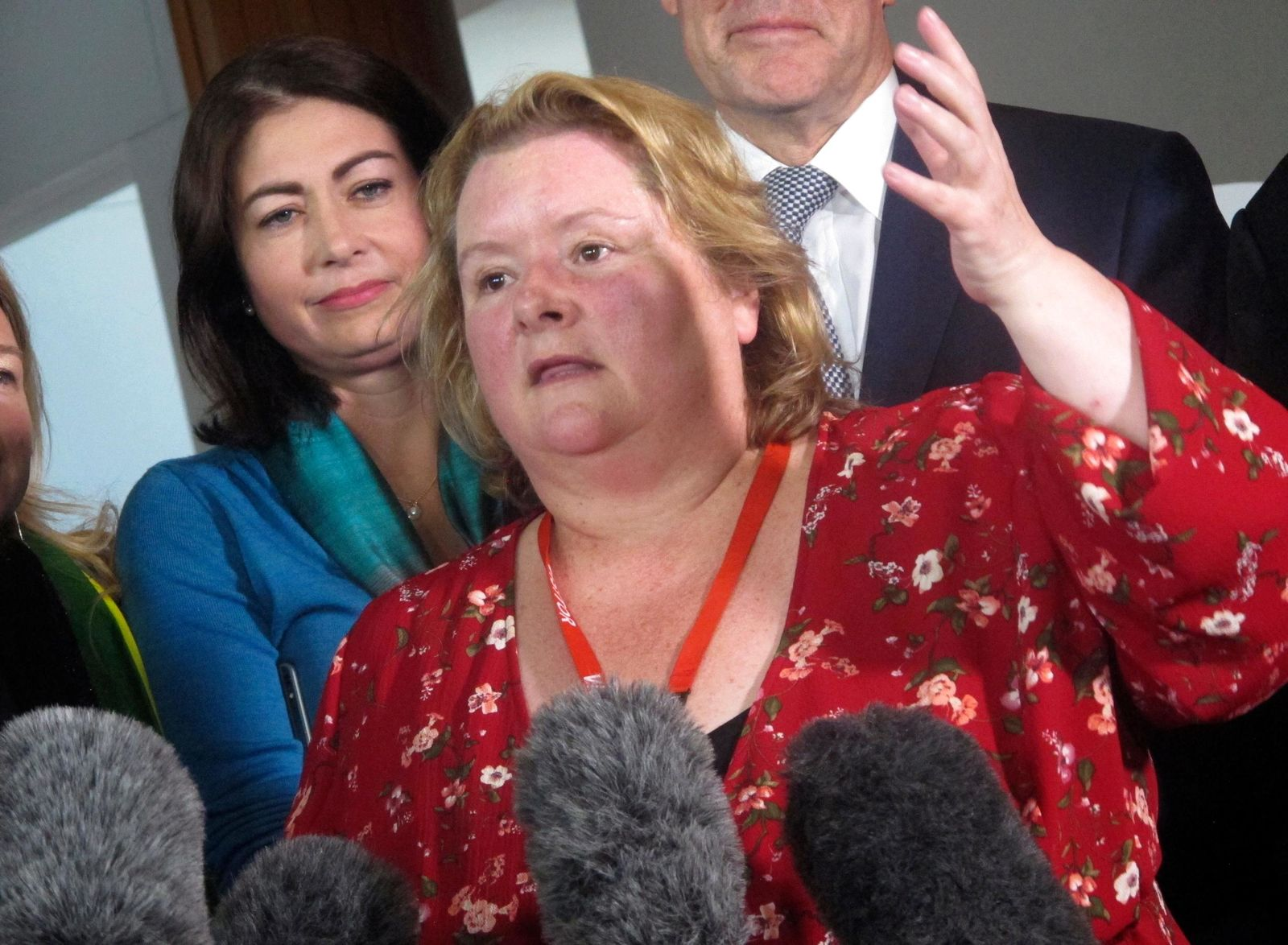 Australian actress Magda Szubanski celebrates at Parliament House in Canberra, Australia, Thursday, Dec. 7, 2017. The Parliament voted to allow same-sex marriage across the nation, following a bitter debate settled by a much-criticized government survey of voters that strongly endorsed change. (AP Photo/Rod McGuirk)