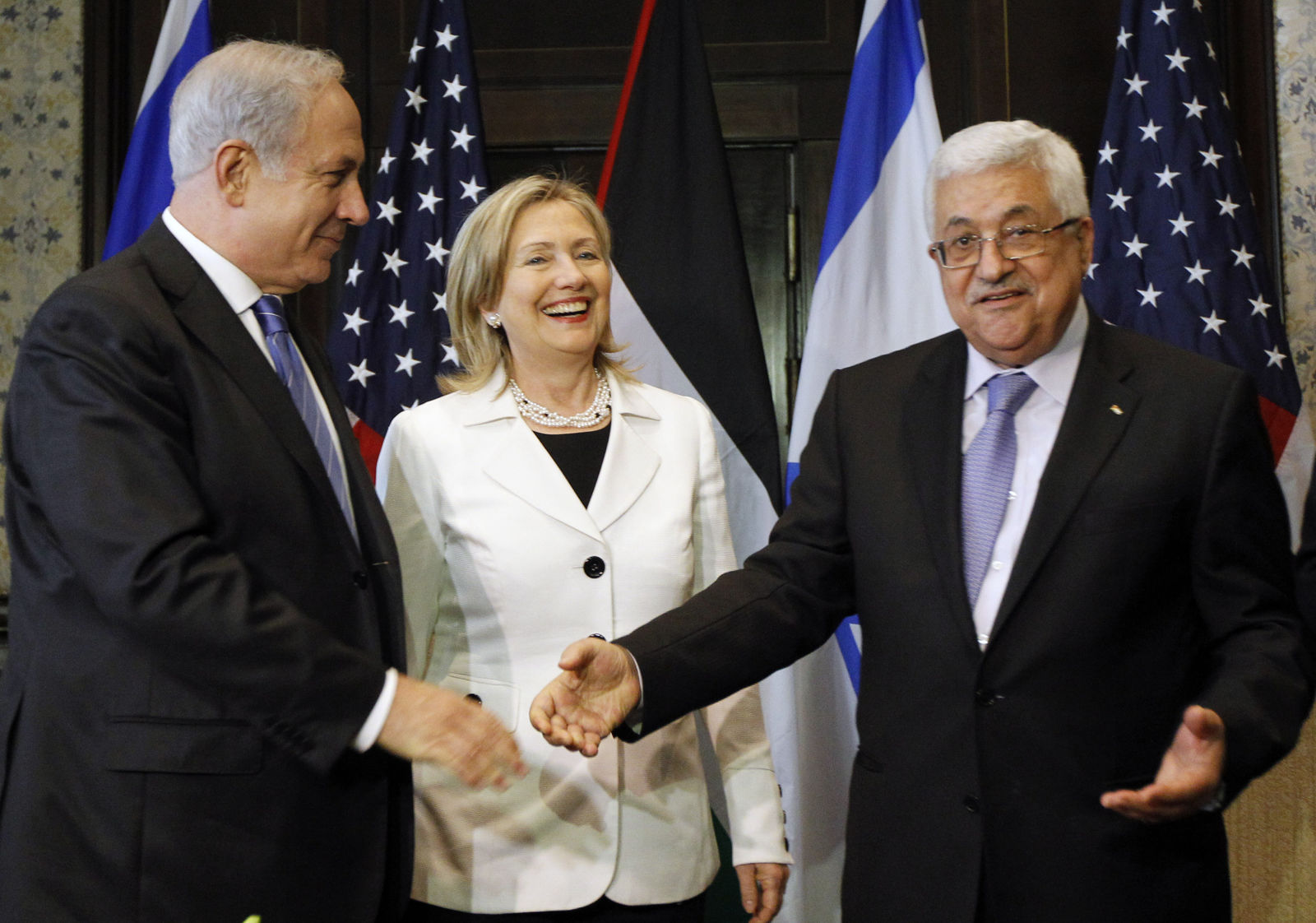 FILE - In this Sept. 14, 2010 file photo, Israeli Prime Minister Benjamin Netanyahu, left, US Secretary of State Hillary Rodham Clinton, and Palestinian President Mahmoud Abbas, meet in Sharm El-Sheikh, Egypt. (AP Photo/Alex Brandon, Pool, File)