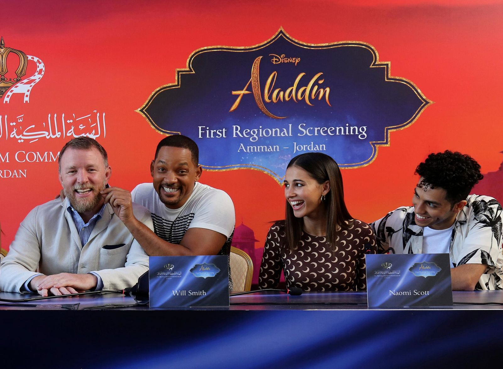 "Actor Will Smith, second right, director Guy Ritchie, left, and cast members Naomi Scott, second right, and Mena Massoud, give a news conference for the regional launching of Disney's live-action ""Aladdin,"" in the Jordanian capital Amman. . (AP Photo/Raad Adayleh)"