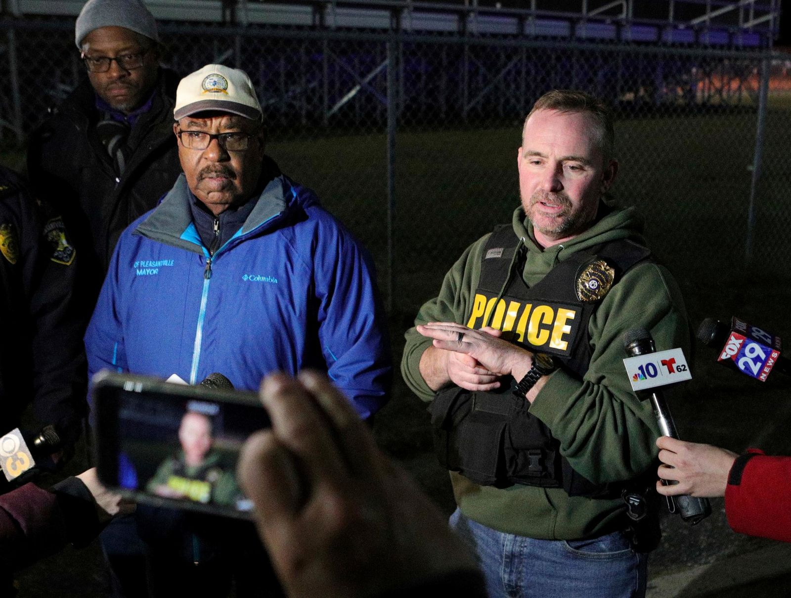 Pleasantville Mayor Jesse L. Tweedle Sr., left and Pleasantville Police Chief Sean Riggin hold a news conference after a shooting that occurred during a football game at Pleasantville High School in Pleasantville, N.J., Friday, Nov. 15, 2019. Players and spectators ran for cover Friday night when a gunman opened fire at the New Jersey high school football game. (Edward Lea/The Press of Atlantic City via AP)