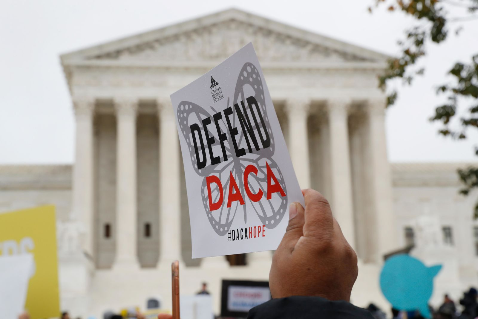FILE - In this Nov. 12, 2019, file photo people rally outside the Supreme Court as oral arguments are heard in the case of President Trump's decision to end the Obama-era, Deferred Action for Childhood Arrivals program (DACA), at the Supreme Court in Washington. DACA recipients are assuming a prominent role in the presidential campaign, working to get others to vote, even though they cannot cast ballots themselves, and becoming leaders in the Democratic campaigns of Bernie Sanders and Tom Steyer as well as get-out-the-vote organizations. (AP Photo/Jacquelyn Martin, File)