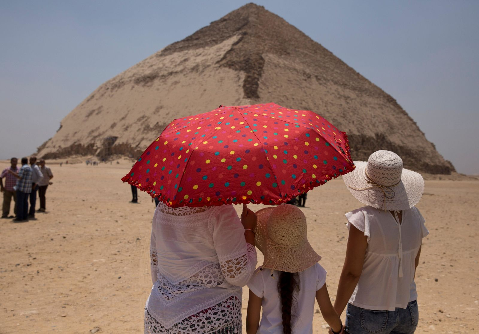 Women visit the Bent Pyramid during an during an event opening the pyramid and its satellites for visitors in Dashur, Egypt, Saturday, July 13, 2019. (AP Photo/Maya Alleruzzo)