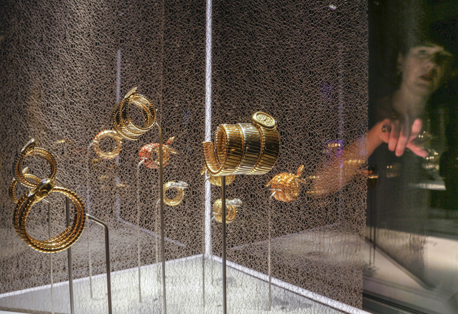 "A woman looks at bracelets on display during a preview of the exhibition ""Bulgari. The story, the dream"" at St. Angel Castle in Rome, Tuesday, June 25, 2019. (AP Photo/Domenico Stinellis)"
