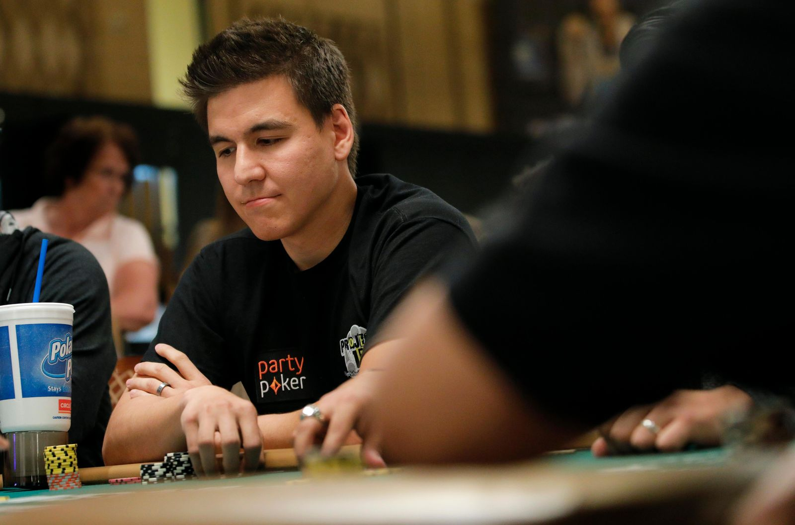 "FILE - In this Monday, June 24, 2019, file photo, ""Jeopardy!"" champion and professional sports gambler James Holzhauer plays in a tournament at the World Series of Poker, in Las Vegas. The three top money winners in ""Jeopardy!"" history, Ken Jennings, Brad Rutter and James Holzhauer, will vie for a share of $1.5 million in January 2020. (AP Photo/John Locher, File)"