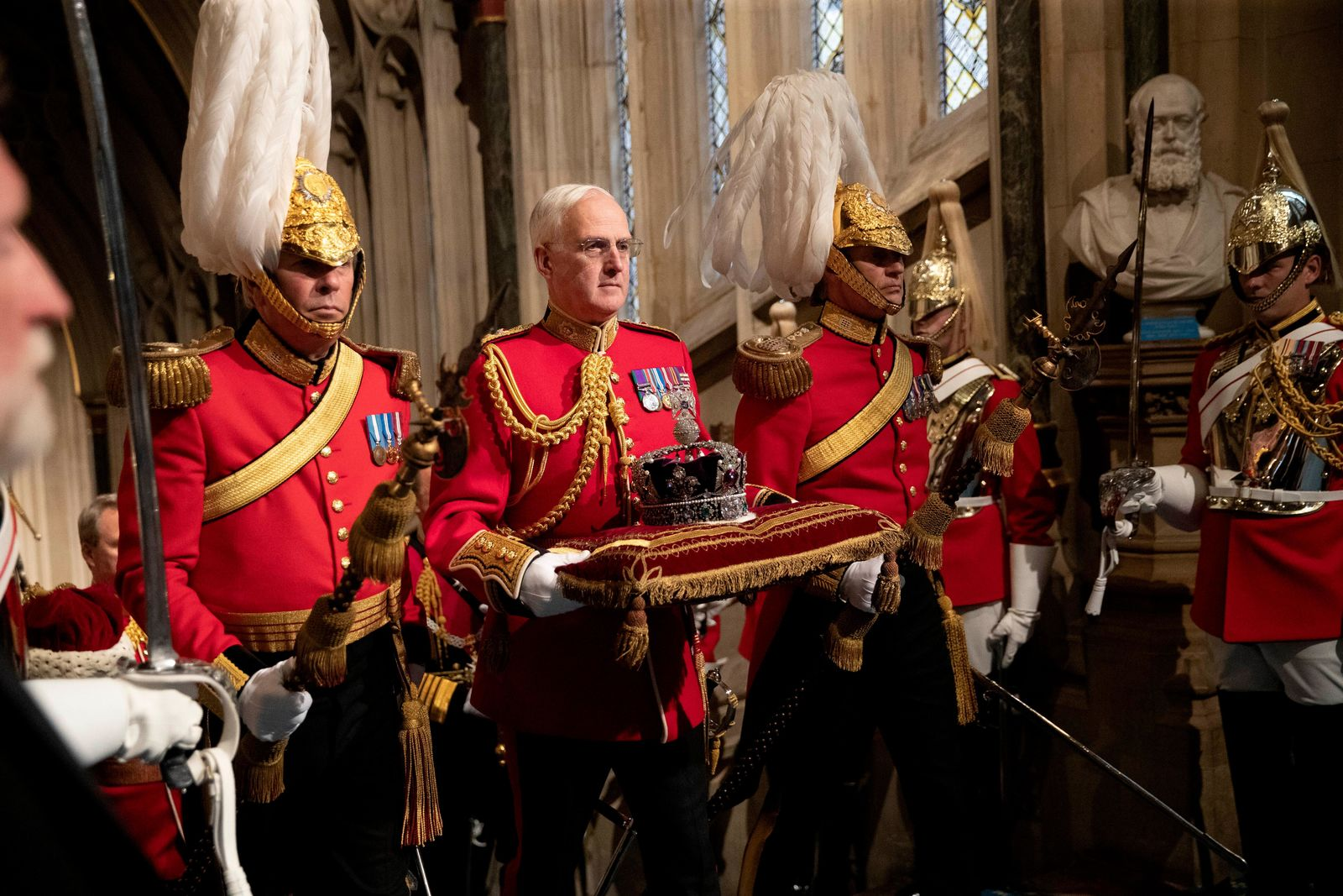 The Imperial State Crown is carried through the Norman Porch at the Palace of Westminster and the Houses of Parliament at the State Opening of Parliament ceremony in London, Monday, Oct. 14, 2019. (AP Photo/Matt Dunham, Pool)