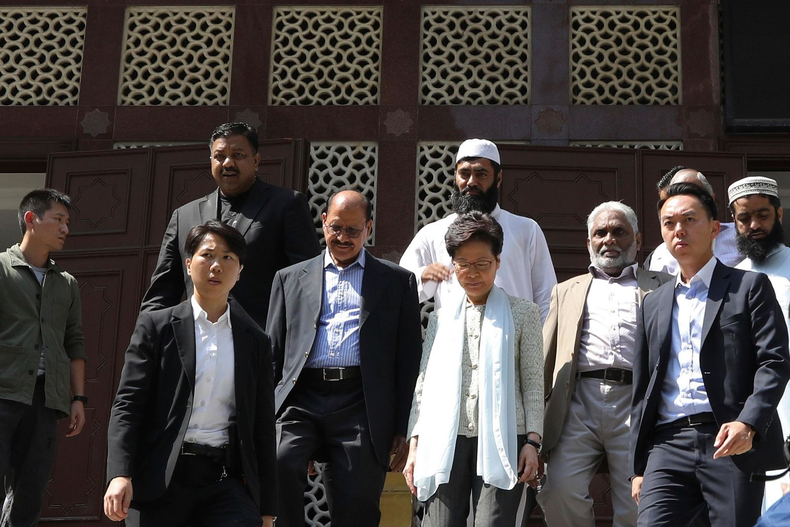 Hong Kong Chief Executive Carrie Lam, center, leaves a mosque in Hong Kong, Monday, Oct. 21, 2019.{ } (AP Photo)