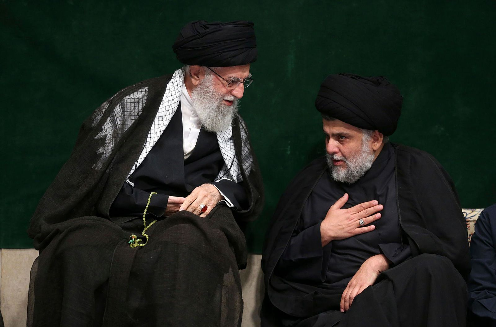 In this picture released by the official website of the office of the Iranian supreme leader, Supreme Leader Ayatollah Ali Khamenei, left, greets Iraqi Shiite cleric Muqtada al-Sadr during a mourning ceremony commemorating Ashoura, the death anniversary of Hussein, the grandson of Prophet Muhammad, in Tehran, Iran. (Office of the Iranian Supreme Leader via AP)