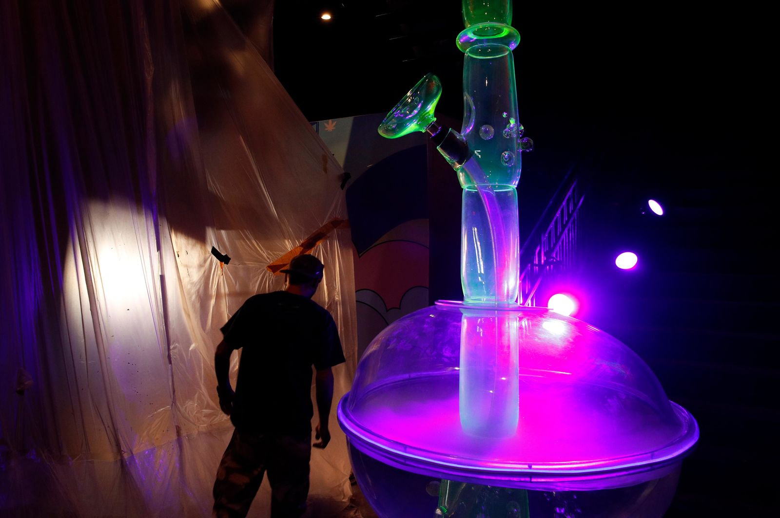 In this Tuesday, Sept. 18, 2018 photo, a man walks by a 24-foot-tall bong at the Cannabition cannabis museum in Las Vegas. (AP Photo/John Locher)