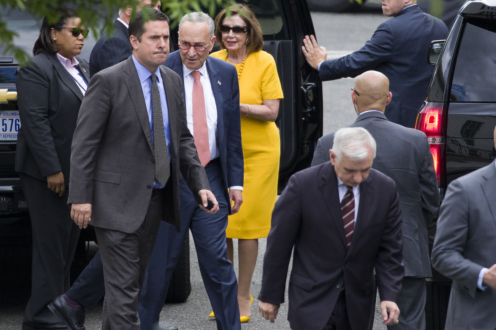 Rep. Devin Nunes, R-Calif., ranking member of the House Intelligence Committee, second from left, Senate Minority Leader Chuck Schumer of N.Y., House Speaker Nancy Pelosi of Calif., Sen. Jack Reed, D-R.I., foreground, and others depart after a meeting with President Donald Trump about Iran at the White House, Thursday, June 20, 2019, in Washington. (AP Photo/Alex Brandon)