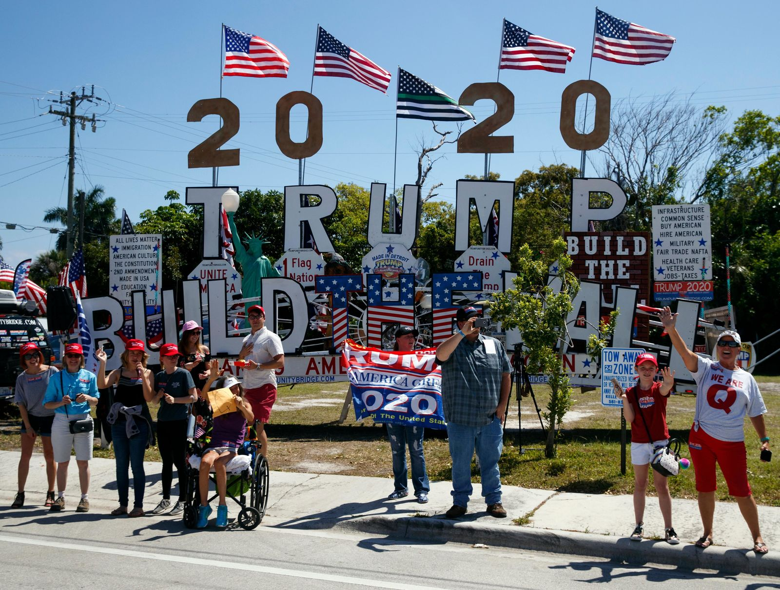 Supporters of President Donald Trump are seen from the media van in the motorcade accompanying the president in West Palm Beach, Fla., Saturday, March 23, 2019, en route to Mar-a-Lago in Palm Beach, Fla. (AP Photo/Carolyn Kaster)