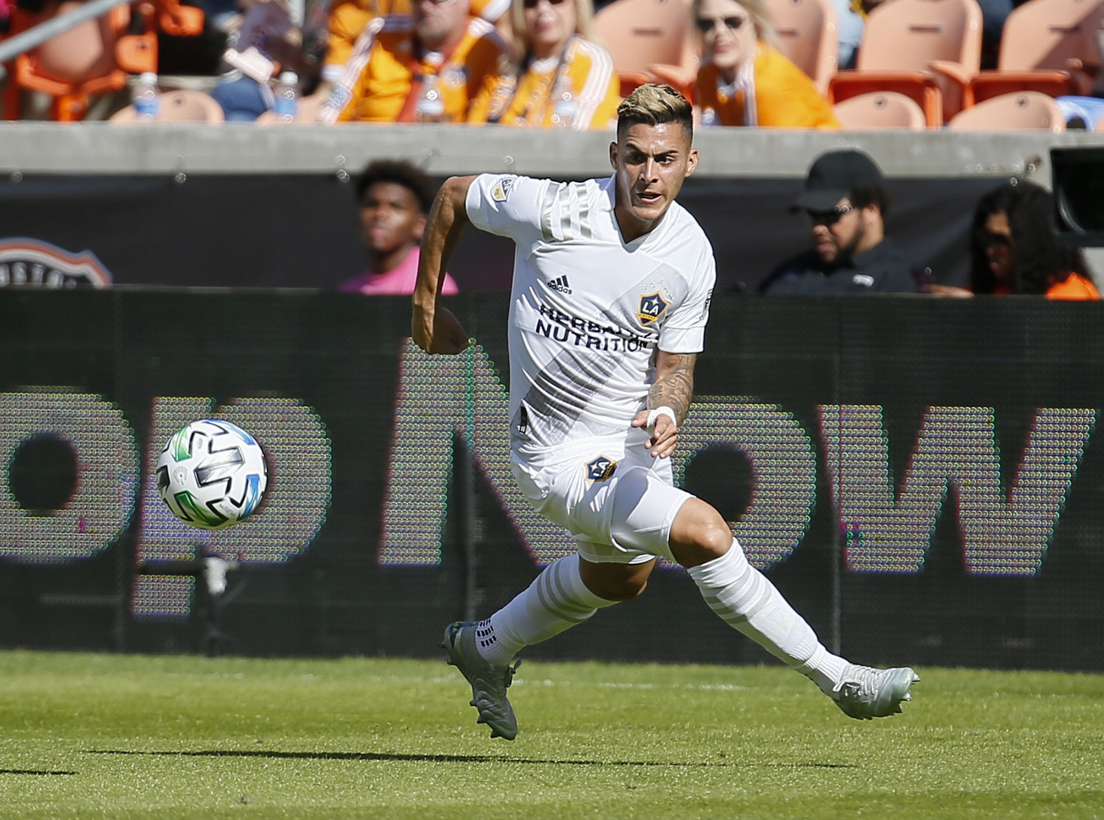 Cristian Pavon #10 of Los Angeles Galaxy runs down the ball before he scores against the Houston Dynamo during the first half at BBVA Stadium on February 29, 2020 in Houston, Texas. (Photo by Bob Levey/Getty Images)