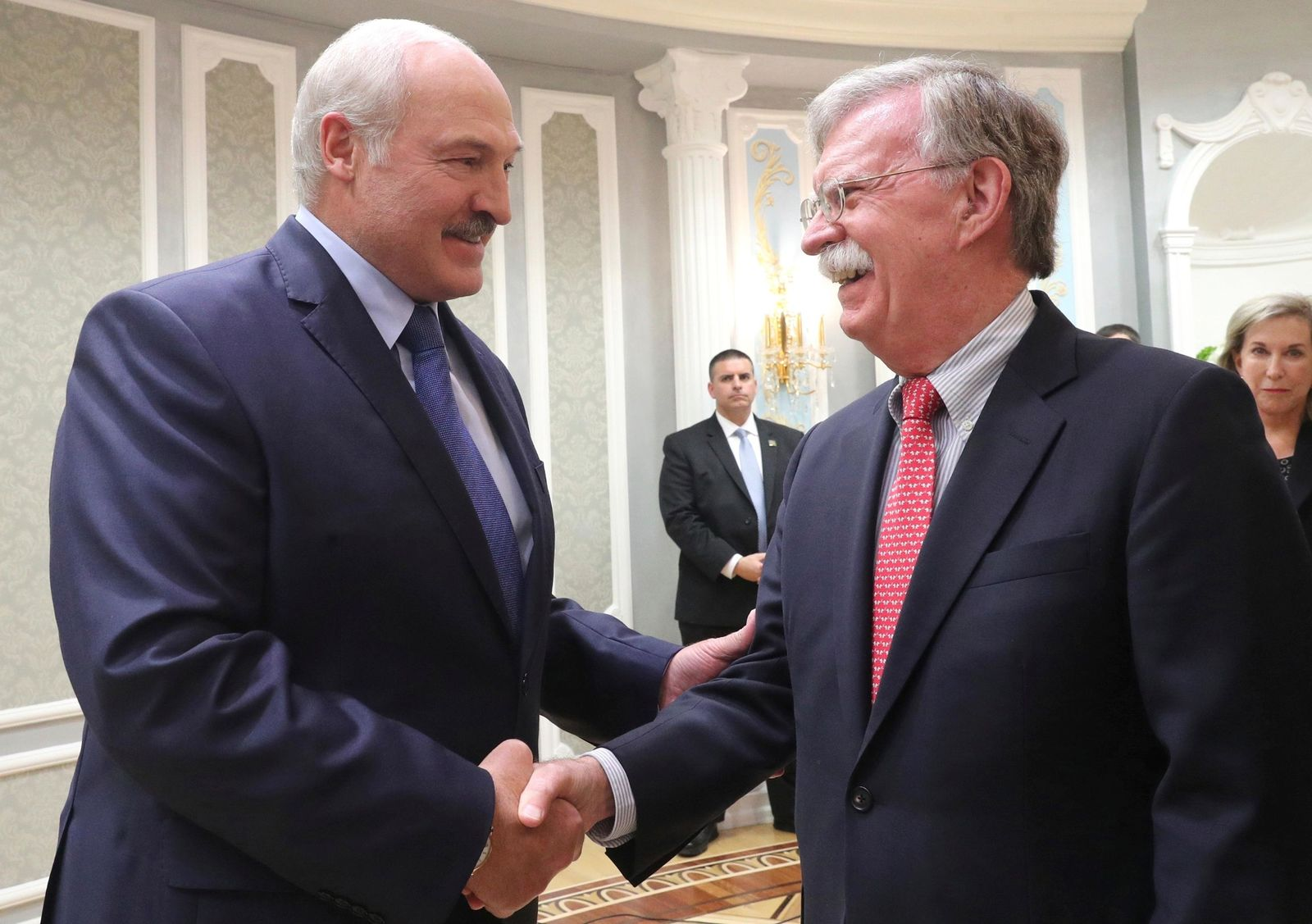 John Bolton, US National Security Advisor, right, is welcomed by Belarusian President Alexander Lukashenko during their meeting in Minsk, Belarus, Thursday, Aug. 29, 2019. (Nikolai Petrov/BelTA Pool Photo via AP)