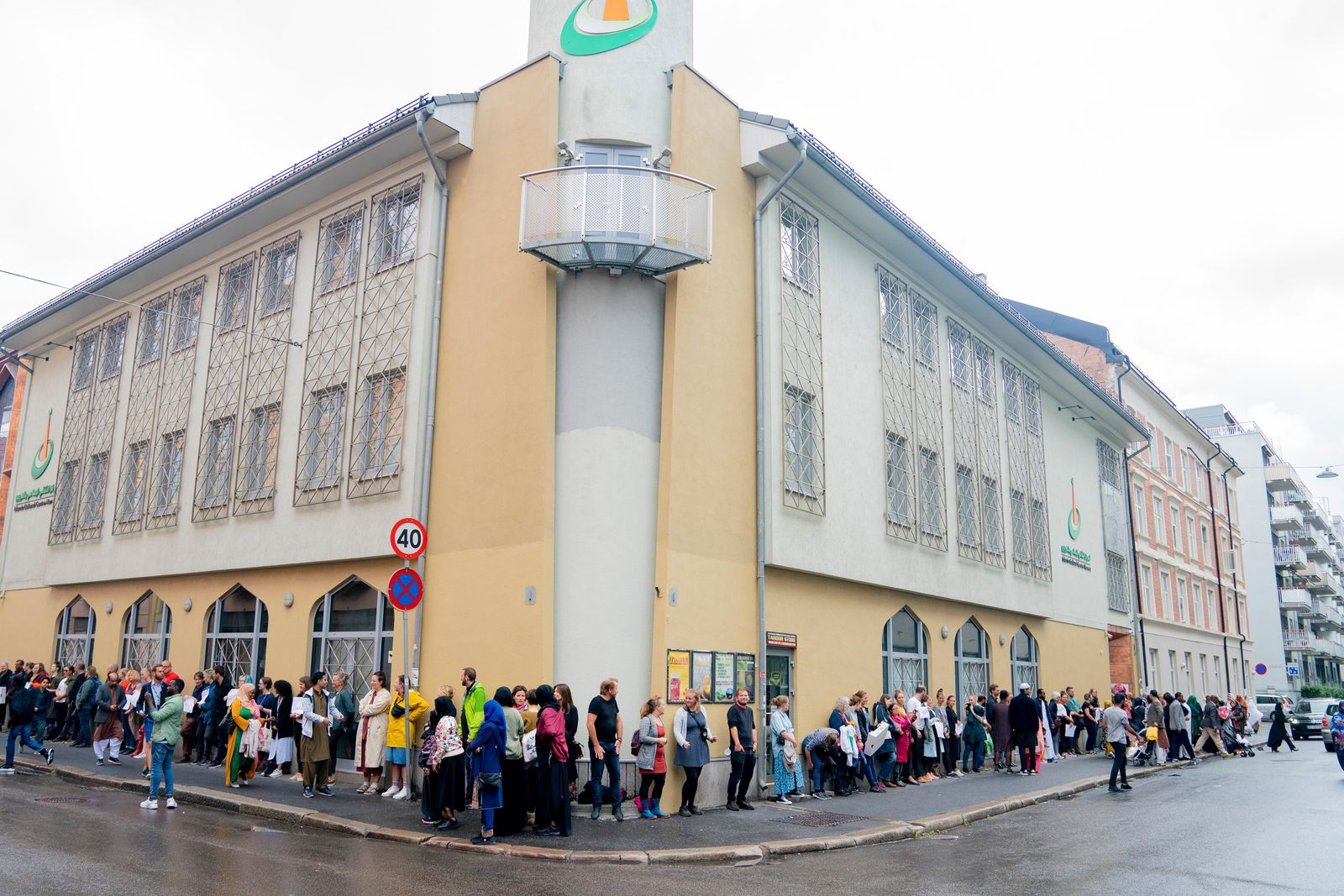 People gather to show support, outside the mosque Islamic Cultural Centre in Oslo, Sunday, Aug. 11, 2019. One person was shot and lightly injured at a mosque in a western suburb of the capital, Oslo on Saturday.{ } (Fredrik Hagen /NTB scanpix via AP)