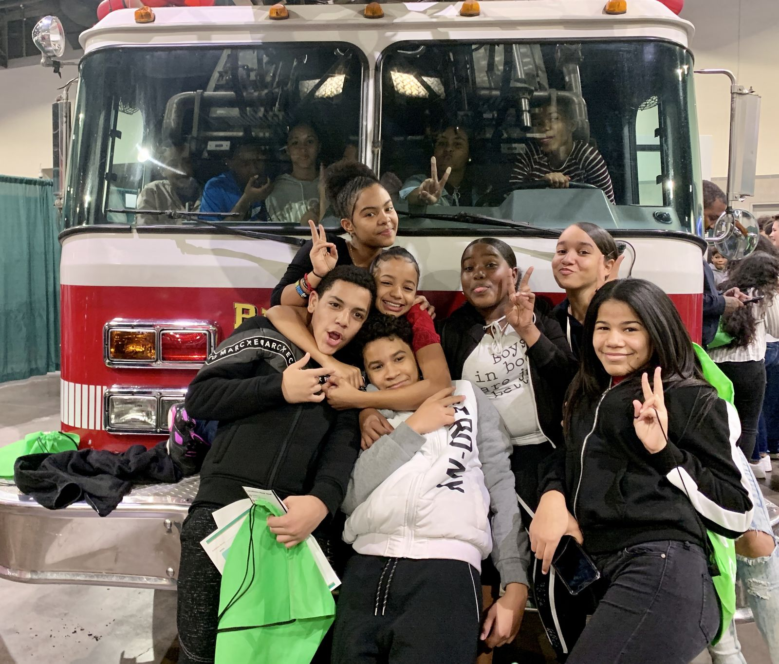 Students from Roger Williams Middle School in Providence pose with a fire truck from the Providence Fire Department. (WJAR){ }