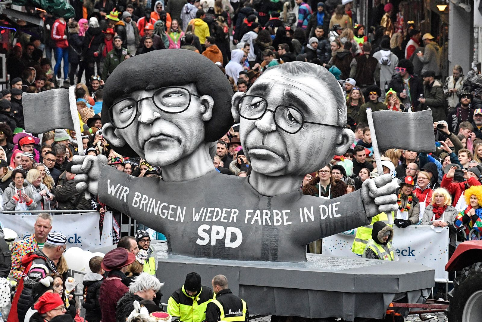 A carnival float depicts grey Social Democratc Party, SPD, leaders Saskia Esken and Norbert Walter-Borjans during the traditional carnival parade in Duesseldorf, Germany, on Monday, Feb. 24, 2020. The foolish street spectacles in the carnival centers of Duesseldorf, Mainz and Cologne, watched by hundreds of thousands of people, are the highlights in Germany's carnival season on Rosemonday. (AP Photo/Martin Meissner)