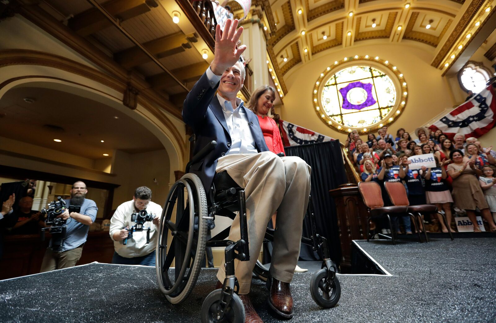 Texas Gov. Greg Abbott waves to supporters as he and his wife, Cecilia, arrive for an event where he announced his bid for re-election, Friday, July 14, 2017, in San Antonio. (AP Photo/Eric Gay)