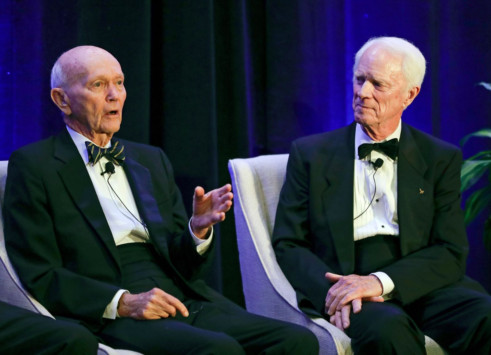 Apollo 11 astronaut Mike Collins, left, makes comments as Apollo 9 astronaut Rusty Schweickart listens during a news conference Tuesday, July 16, 2019, in Cocoa Beach, Fla. (AP Photo/John Raoux)