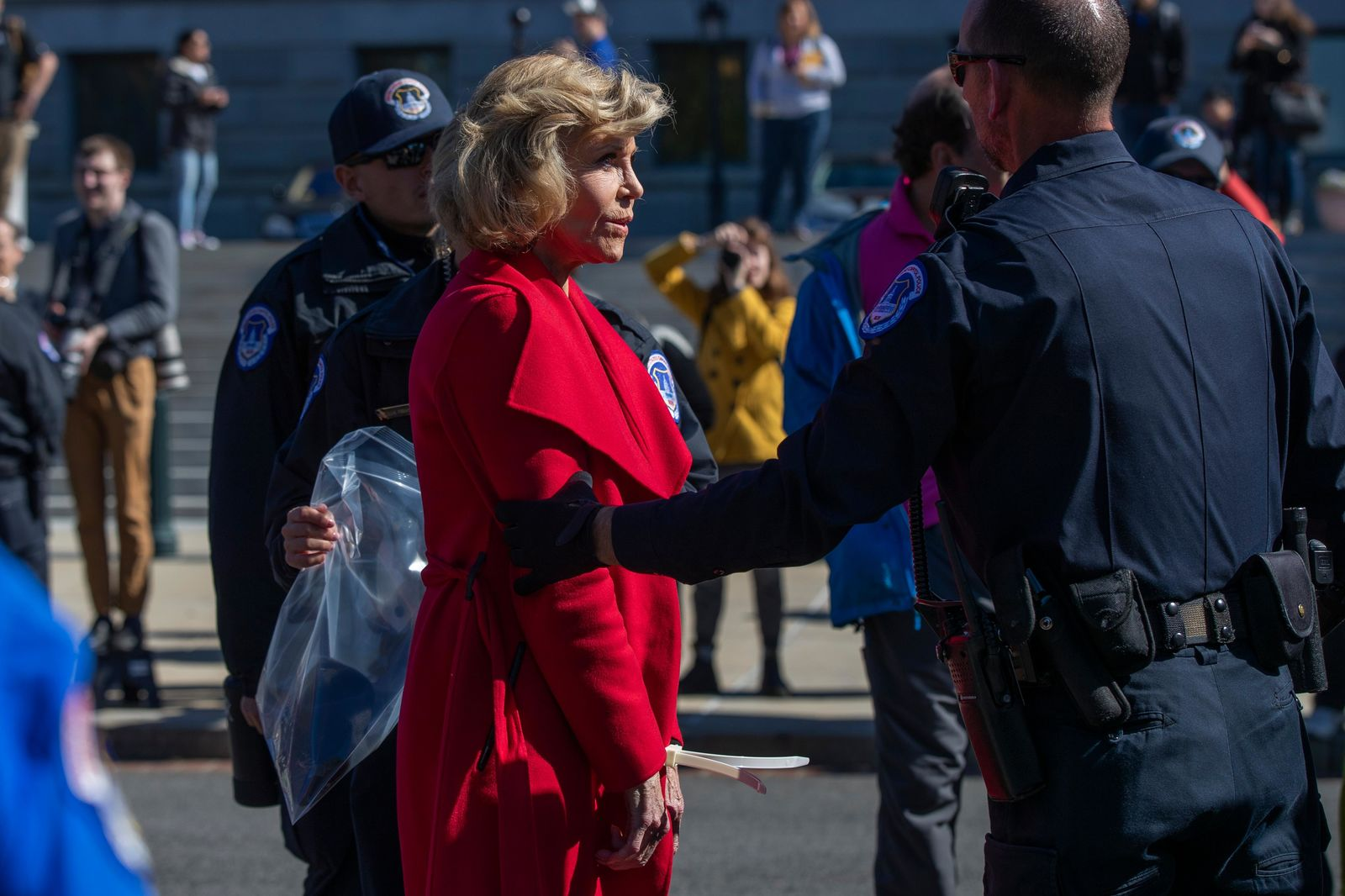 Actress Jane Fonda is arrested by U.S. Capitol Police officers during a rally on Capitol Hill in Washington, Friday, Oct. 18, 2019. A half-century after throwing her attention-getting celebrity status into Vietnam War protests, 81-year-old Jane Fonda is now doing the same in a U.S. climate movement where the average age is 18. (AP Photo/Manuel Balce Ceneta)