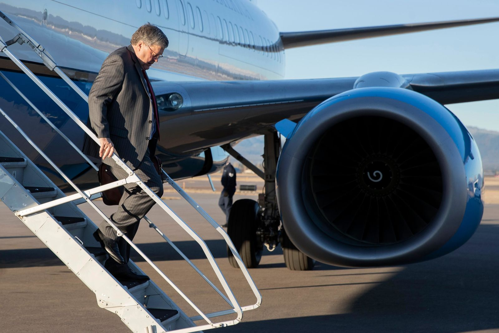 Attorney General William Barr steps off an aircraft at Glacier Park International Airport, Thursday, Nov. 21, 2019, in Kalispell, Mont. Barr is scheduled Friday to visit Flathead Reservation to address the issue of missing and murdered indigenous persons. (AP Photo/Patrick Semansky)