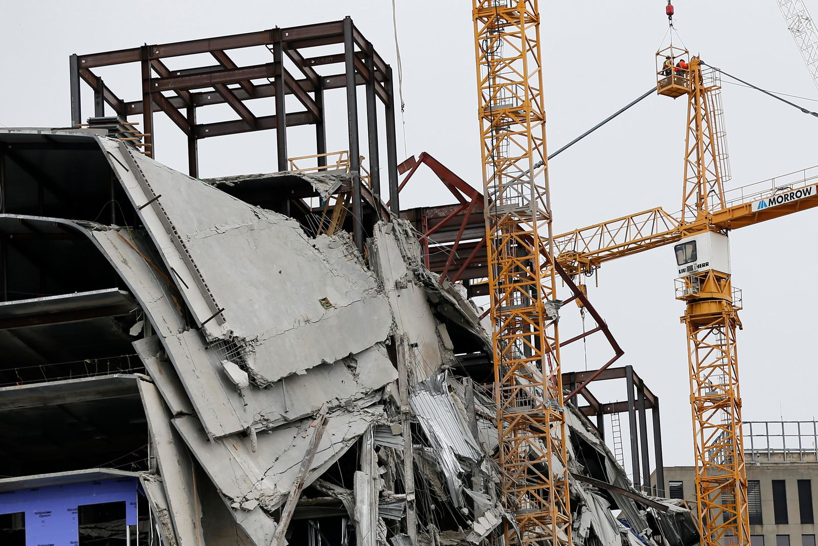 Workers begin the process of preparing the two unstable cranes for implosion at the collapse site of the Hard Rock Hotel, which underwent a partial, major collapse while under construction last Sat., Oct., 12, in New Orleans, Friday, Oct. 18, 2019. (AP Photo/Gerald Herbert)