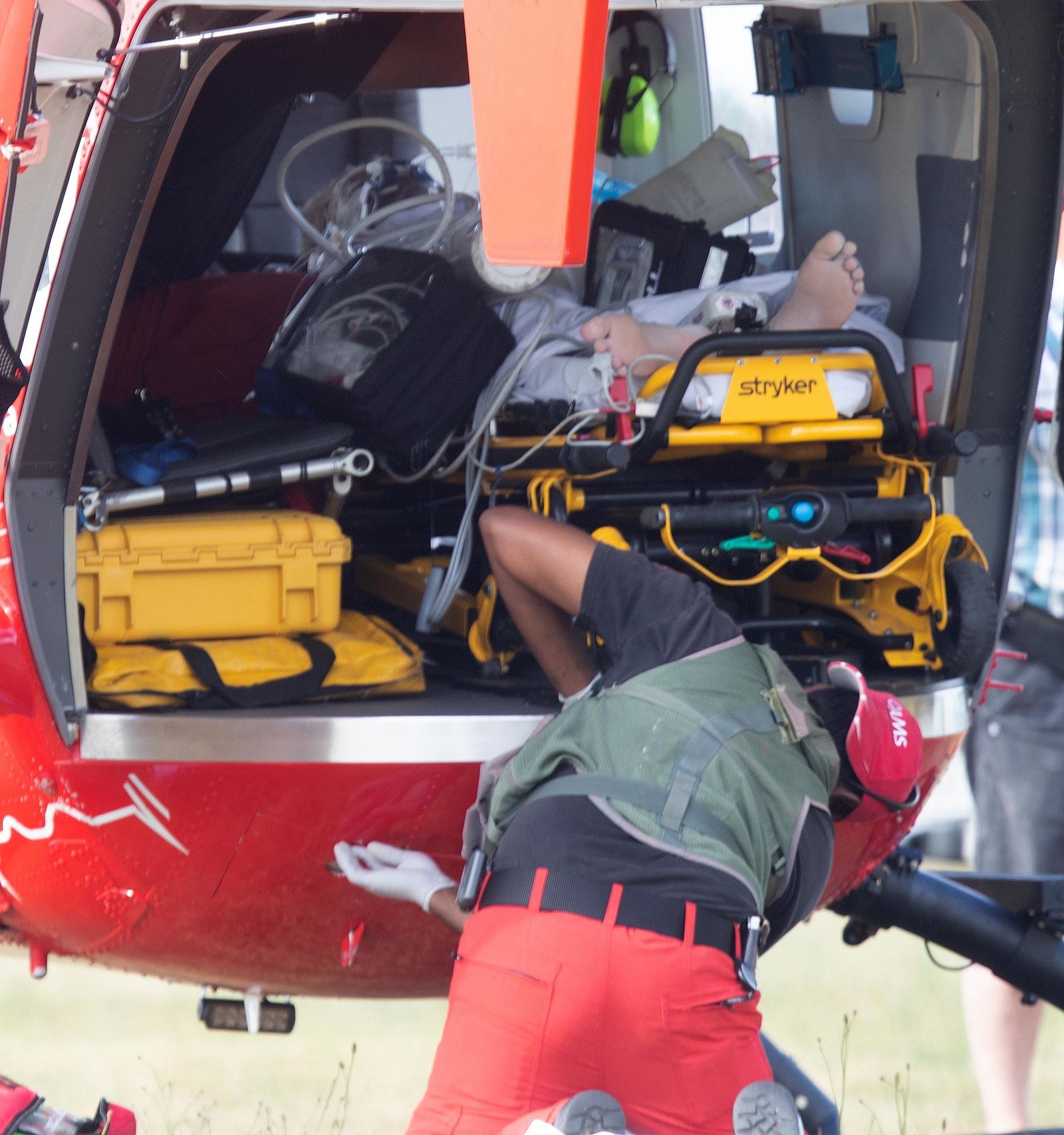 Emergency services attend to an injured person arriving at the Whakatane Airfield after the volcanic eruption Monday, Dec. 9, 2019, on White Island, New Zealand. (Alan Gibson/New Zealand Herald via AP)