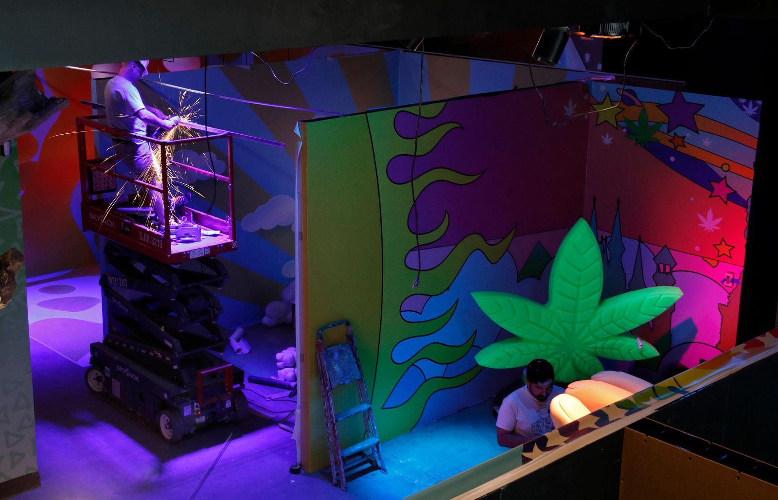 In this Tuesday, Sept. 18, 2018 photo, workers finish exhibits at the Cannabition cannabis museum in Las Vegas.{ } (AP Photo/John Locher)