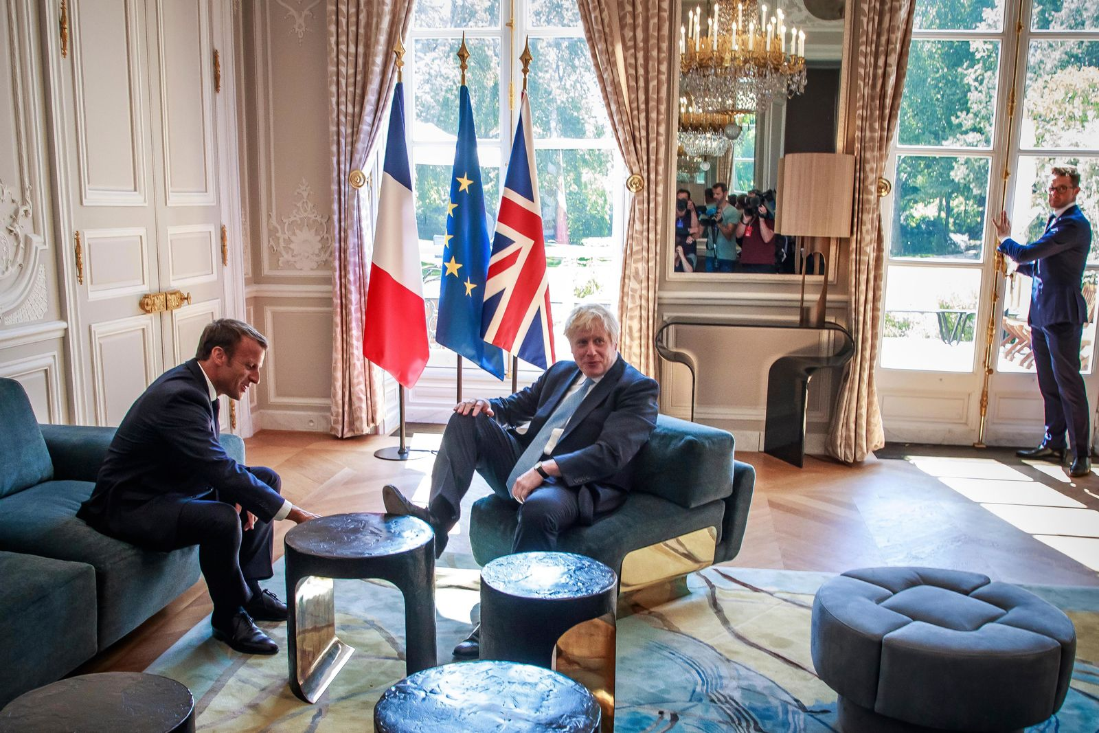 French President Emmanuel Macron, left, talks to Britain's Prime Minister Boris Johnson during their meeting at the Elysee Palace, Thursday, Aug. 22, 2019 in Paris.{ } (Christophe Petit Tesson, Pool via AP)